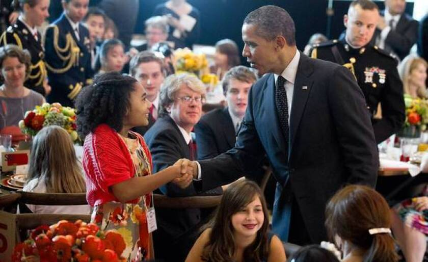 """President Obama greets guests of a """"Kids' State Dinner"""" last week hosted by First Lady Michelle Obama. The president has said he counts his failure to bridge the nation's partisan gap as one of his biggest frustrations."""