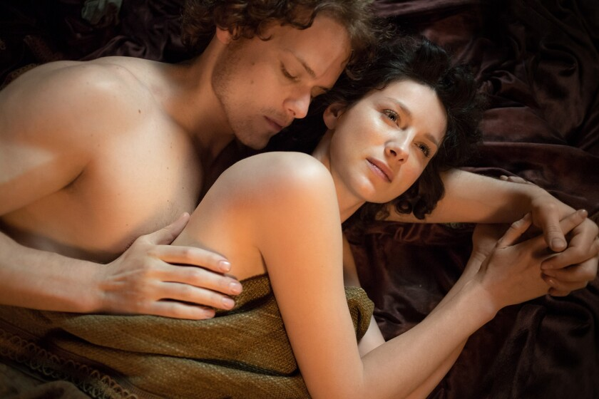 Claire Randall (Caitriona Balfe) and Jamie Fraser (Sam Heughan) in 'Outlander.'
