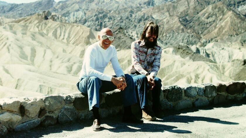 "(L-R)- A photograph of Michel Foucault and Michael Stoneman in the book ""Foucault in California."" Cr"