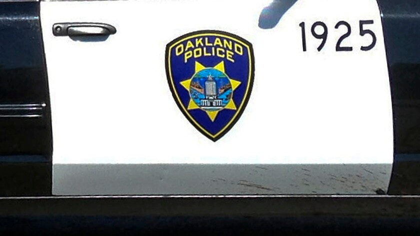 Oakland Police logo on the side of a patrol car