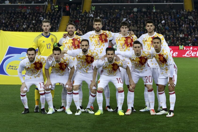 FILE - In this Thursday, March 24, 2016 file photo, the Spanish team poses prior to a friendly soccer match between Italy and Spain, at the Friuli Dacia Arena stadium in Udine, Italy. Front row, from left, Juan Mata, Cesar Azpilicueta, Torres Belen Juanfran, Cesc Fabregas, Aritz Aduriz  and Thiago