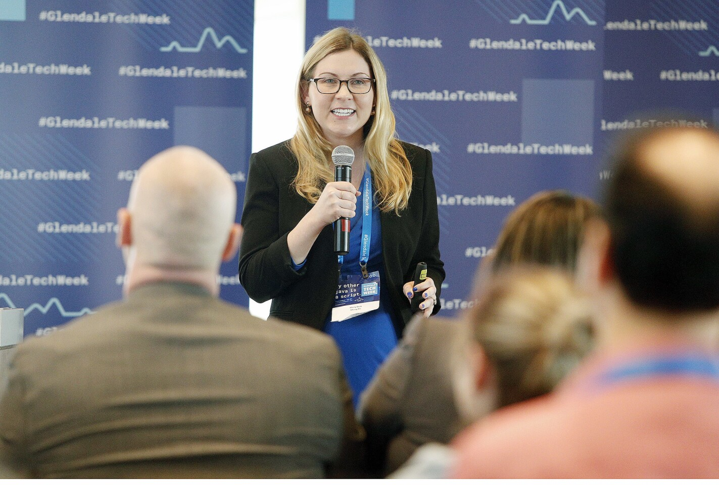 Molly Beck, of Messy.fm, pitches a line of judges about her company for PitchFest, part of Glendale's 2018 Tech Week at CBRE in Glendale on Thursday, September 20, 2018. PitchFest is a Shark Tank-like opportunity for companies to pitch their business ideas to a panel, with the hopes of taking home a $60,000 prize.