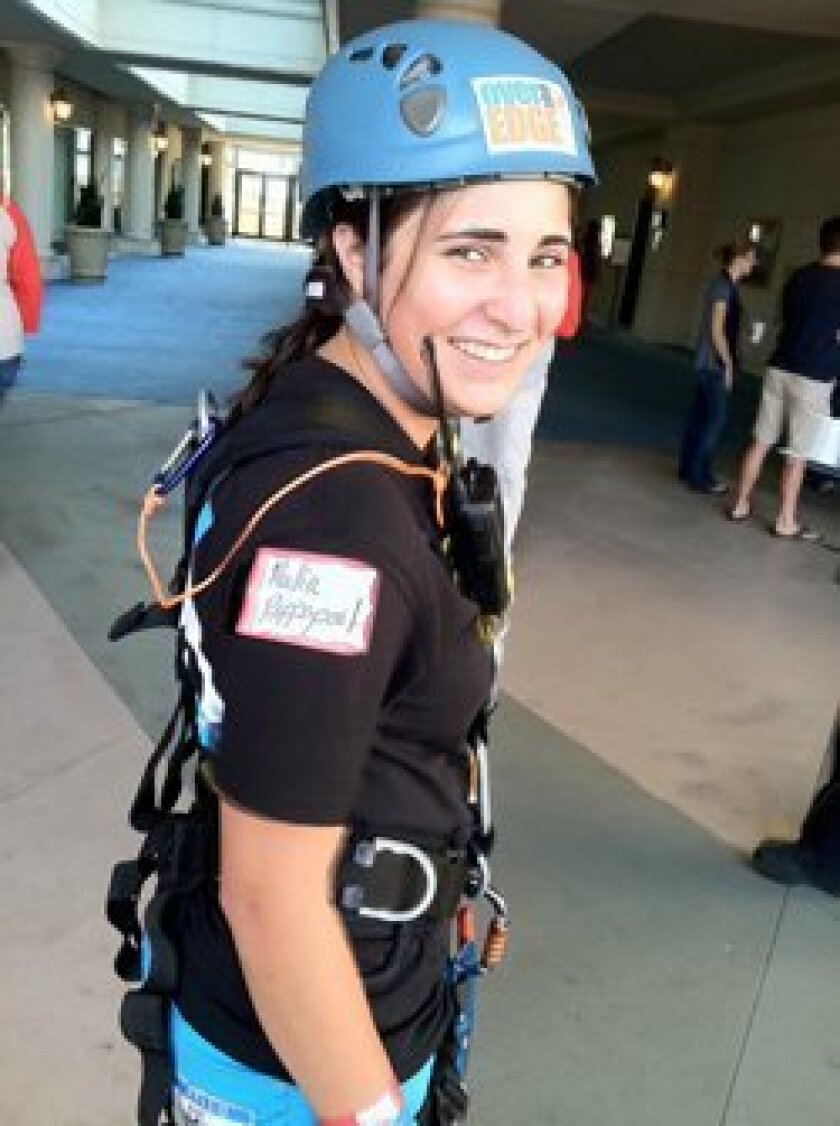 """Malia Rappaport as she prepared to step off the top of the 33-story Manchester Grand Hyatt in the third annual """"Over the Edge"""" event for Kids Included Together (KIT), a national non-profit based in San Diego that promotes inclusion for kids with disabilities."""