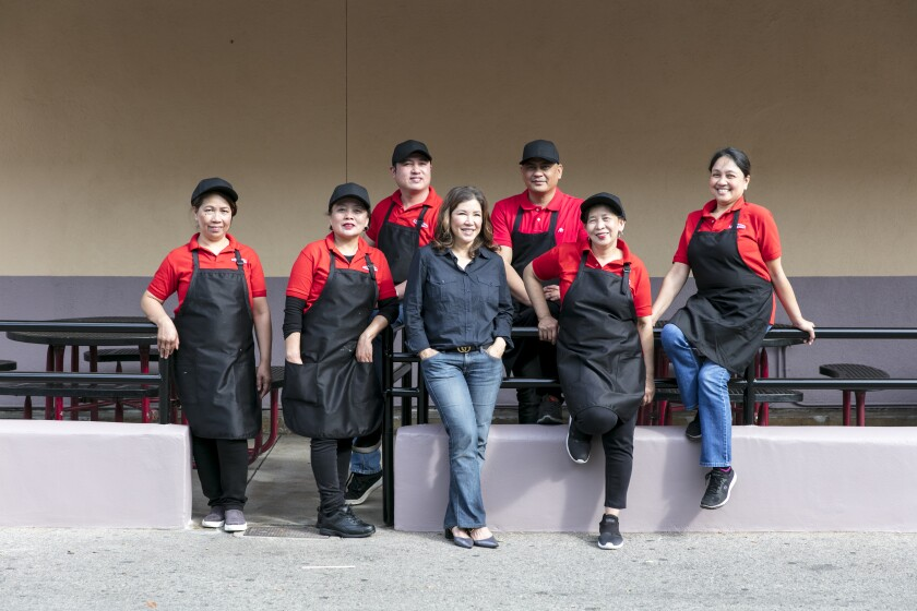 Arko Foods International owner Susie Fong, joined by her staff