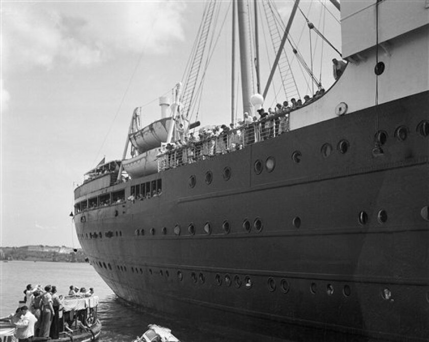 FILE - In this file photo of June 1, 1939, the German liner St. Louis is denied entrance to the Havana, Cuba harbor. The ship, carrying 917 German Jewish refugees, was later denied entrance to the United States and returned to Hamburg, Germany. A new book disputes widely held assumptions that President Franklin D. Roosevelt was insensitive to the plight of European Jews under the Nazis, and instead concludes that he tried to arrange resettlement for thousands of refugees in the late 1930s, only to be thwarted by his own State Department. (AP Photo, file)