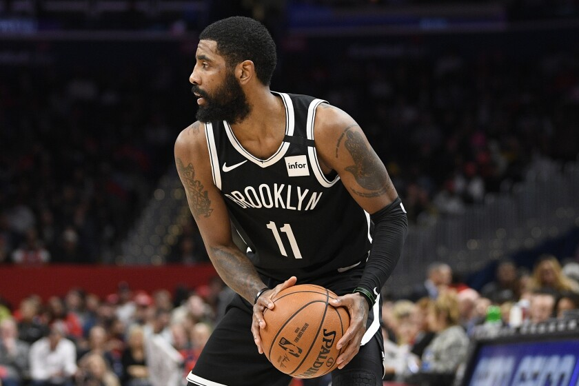 Brooklyn Nets guard Kyrie Irving plays in a game Feb. 1 against the Wizards in Washington.