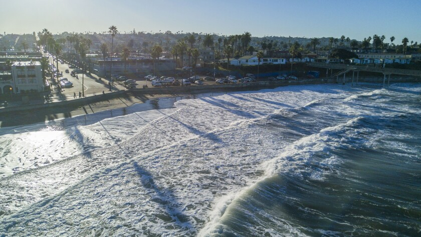 Waves rolled up to the sea wall in Ocean Beach, San Diego, on the first King Tide of the decade on Friday, January 10, 2020.