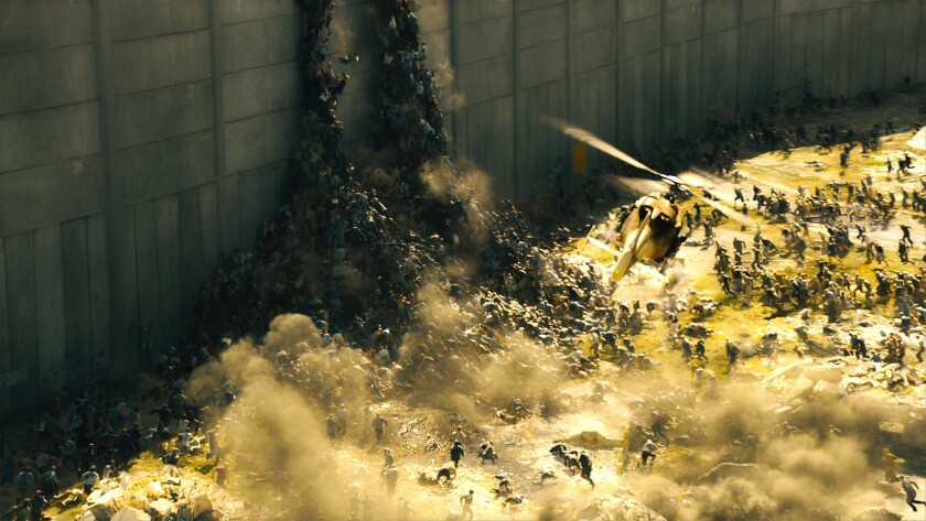 "This publicity image released by Paramount Pictures shows a scene from ""World War Z."" The zombies in ""World War Z"" move with Carl Lewis speed and a swarm-like mentality inspired in part by rabid dogs."