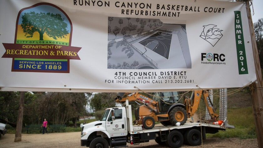 A sign in Runyon Canyon park touting the construction of the new basketball court is seen on April 7.