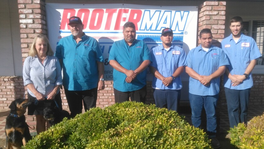 Rooter-Man of Ramona staff focus on providing good customer service. Shown, from left, are Owners Christine and Eric Brockmire, Vice-President and Co-Owner Alex Gomez, and staff members Jose Reyes, Luis Loya and Chandler Ferguson. Also shown are their pets, Ryker and Kayla.