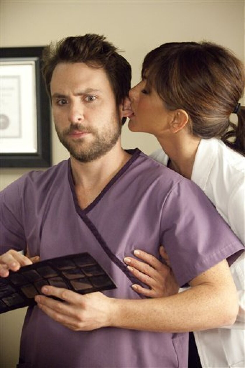 """In this film publicity image released by Warner Bros. Pictures, Charlie Day, left, and Jennifer Aniston are shown in a scene from """"Horrible Bosses."""" (AP Photo/Warner Bros. Pictures, John P. Johnson)"""