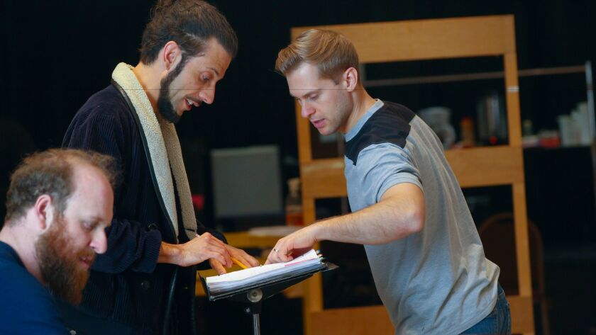 """Director Alexander Gedeon, second from left, works with Canadian tenor Adrian Kramer, right, during rehearsals of San Diego Opera's production of Peter Brook's """"The Tragedy of Carmen."""""""