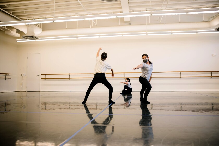 The Wooden Floor students from left Jasmine Lopez, Paola Ross, and Daniela Salazar, in rehearsal in 2021.