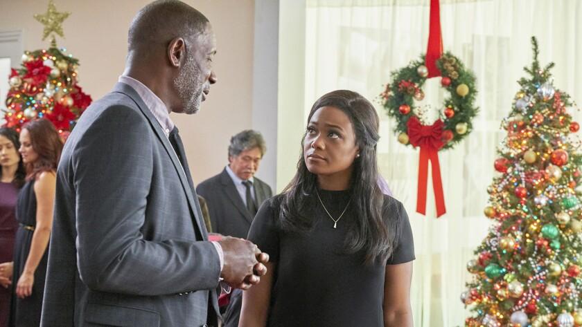 "Dennis Haysbert and Tatyana Ali in the TV movie ""Christmas Everlasting"" on Hallmark."