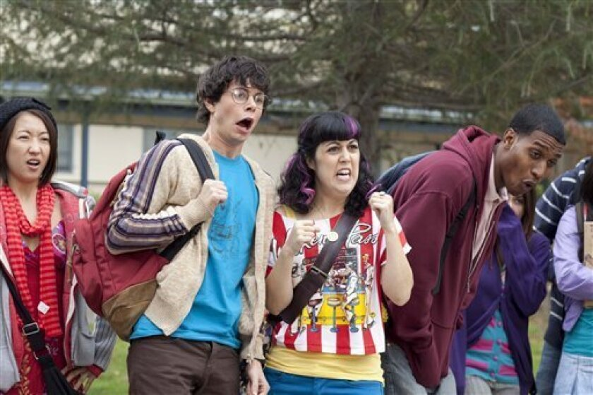 "In this publicity image released by MTV, Paul Iacono, center left, and Kara Taitz, center right, are shown in a scene from the scripted comedy series, ""The Hard Times of RJ Berger,"" premiering Sunday, June 6, 2010 on MTV. (AP Photo/MTV)"