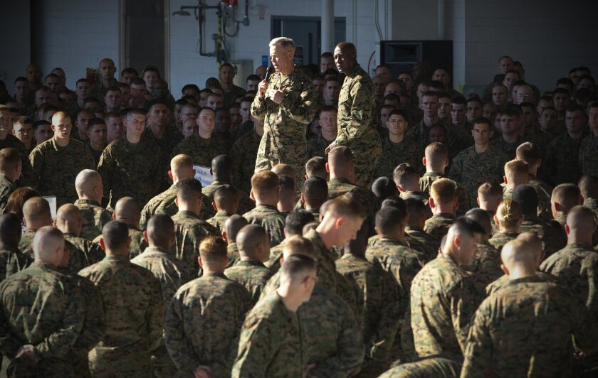 Marine Commandant James Amos (left) and Sgt. Maj. Carlton Kent speak with the troops at the Miramar Marine Corps Air Station.