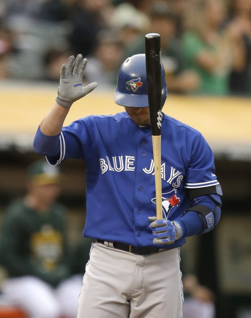Toronto Blue Jays' Josh Donaldson acknowledges fans in his first at bat against the Oakland Athletics since being traded to Toronto in the first inning of a baseball game Tuesday, July 21, 2015, in Oakland, Calif. (AP Photo/Ben Margot)