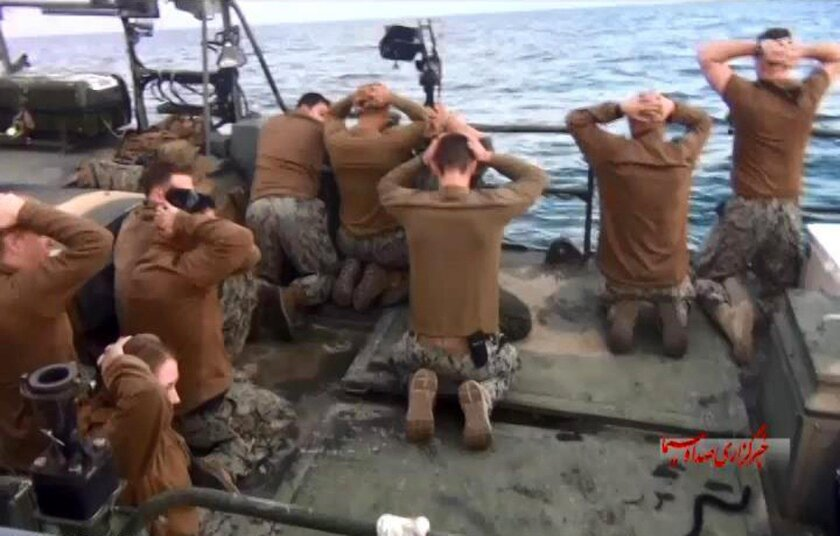 This picture released by the Iranian state-run IRIB News Agency on Wednesday, Jan. 13, 2016, shows detention of American Navy sailors by the Iranian Revolutionary Guards.