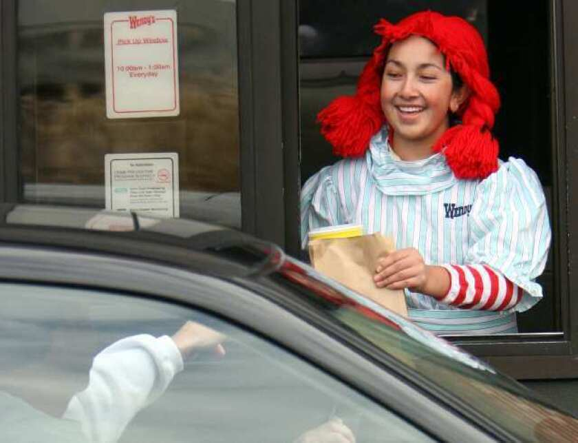 A worker at a Wendy's drive-thru. The chain had the fastest drive-thrus in the industry last year, filling orders in an average of 145.5 seconds.