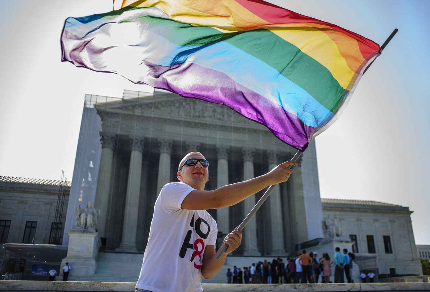 "In June, the court propelled same-sex marriage forward with a pair of rulings that are easier to praise for their result than for their legal reasoning. In U.S. vs. Windsor, the court struck down a section of the federal Defense of Marriage Act, which defined marriage for federal purposes as the union of a man and a woman. The court rightly recognized that the law was animated by a ""congressional desire to harm a politically unpopular group."" On the same day that it invalidated DOMA, the court ruled that supporters of California's Proposition 8 banning same-sex marriage lacked standing to appeal a federal judge's finding that the law was unconstitutional. Although the court sidestepped the merits, the decision set the stage for the resumption of same-sex marriage in the state. Above: A same-sex marriage supporter in front of the Supreme Court. RELATED: Ted Rall's five best cartoons of 2013 Washington's 5 biggest 'fails' of 2013 10 groundbreaking women we lost in 2013"