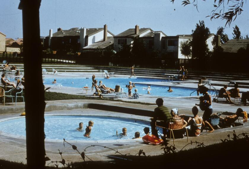 A pool at the University Park village in Irvine is filled with swimmers. University Park is the oldest neighborhood in Irvine.