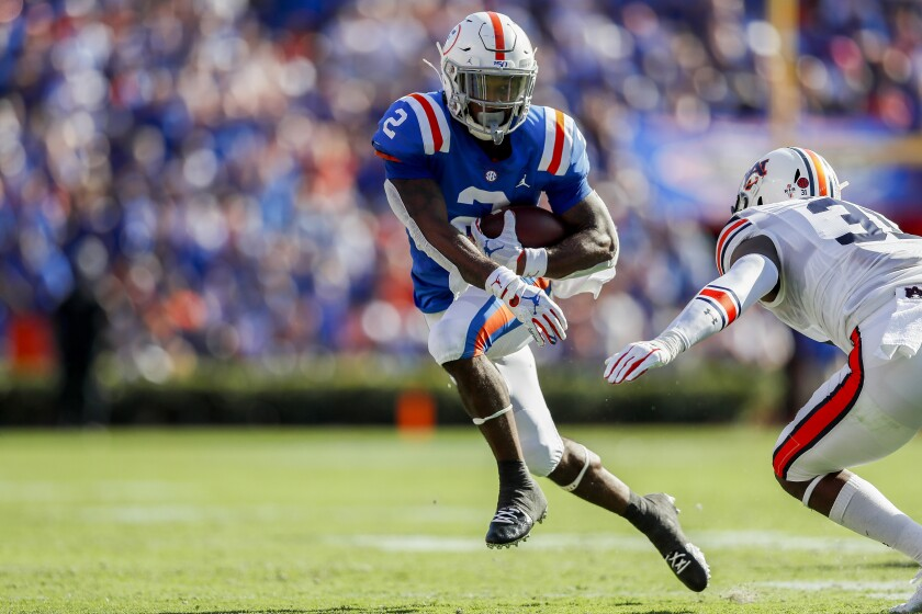 Florida's Lamical Perine runs for yardage during the second quarter against Auburn on Saturday in Gainesville, Fla.