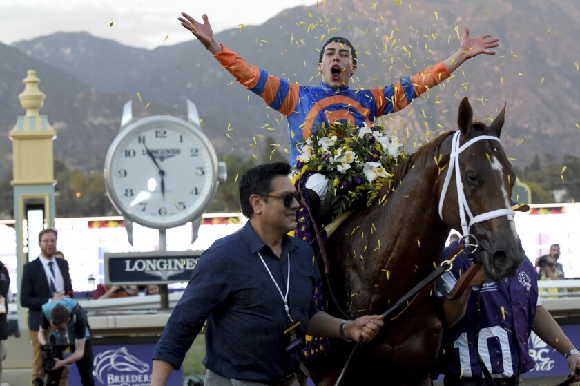 Jockey Irad Ortiz, Jr. celebrates on the way to the Winner's Circle after guiding Vino Rosso to victory in the Breeders' Cup Classic on Nov. 2, 2019, at Santa Anita Park.