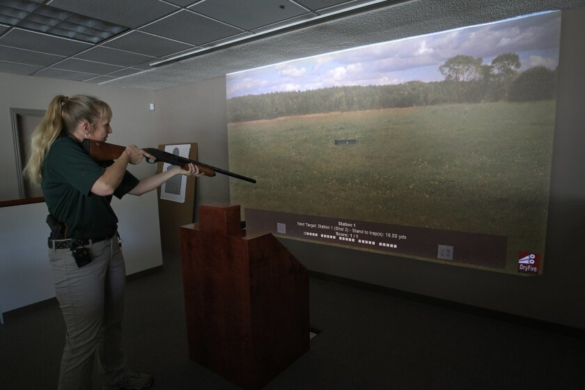The first law enforcement style shooting simulator is now open and available to civilians at Empowered Firearms, a new firearm training and gun store in Vista. LeAnne Farmer, an owner of the facility, demonstrates the store's skeet shooting simulator.