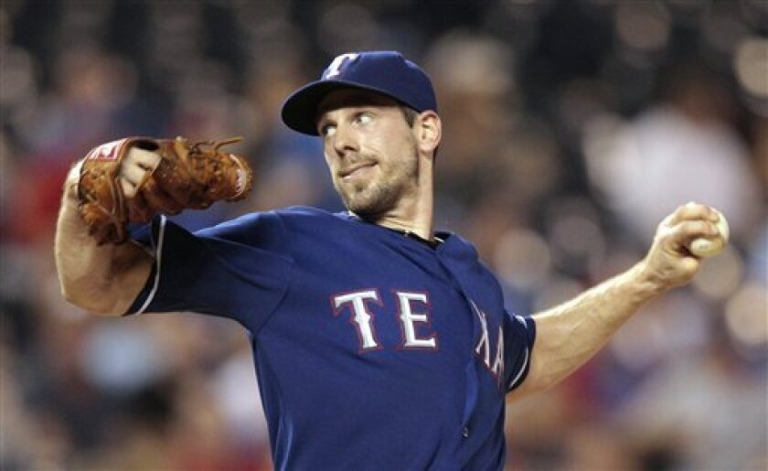 Texas Rangers starting pitcher Cliff Lee throws during the third inning of a baseball game against the Kansas City Royals on Tuesday, Aug. 31, 2010, in Kansas City, Mo. (AP Photo/Charlie Riedel)