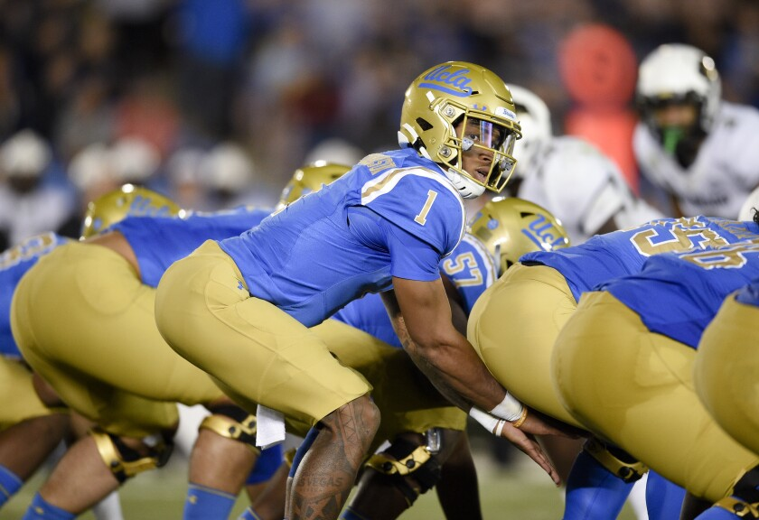 UCLA quarterback Dorian Thompson-Robinson prepares for the snap during a game against Colorado on Nov. 2.
