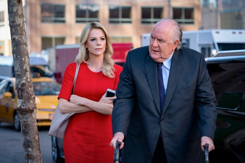 """Charlize Theron as Megyn Kelly and John Lithgow as Roger Ailes in """"Bombshell."""""""