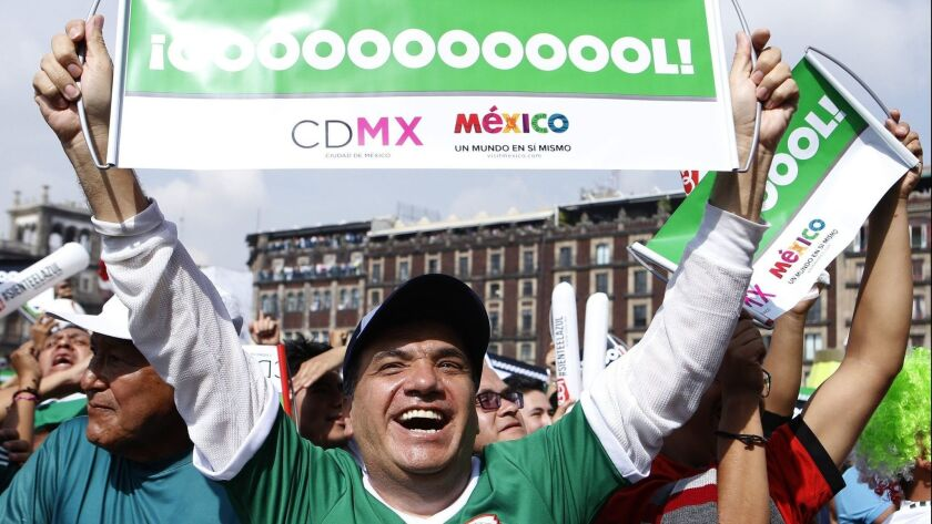 Fans of Mexico gather at the zocalo square in Mexico City on Saturday to watch the World Cup match between Mexico and South Korea.