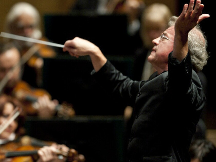Osmo Vanska leads members of the Minnesota Orchestra.