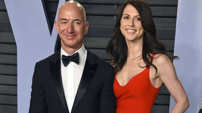 Jeff Bezos and wife MacKenzie Bezos arrive at the Vanity Fair Oscar Party in Beverly Hills on March 4.