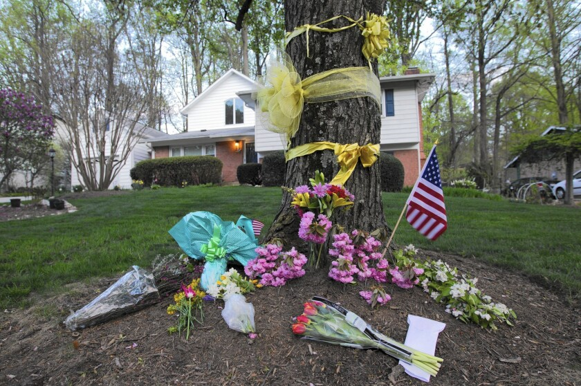Flowers and ribbons adorn a tree outside the Weinstein family house in Rockville, Md.