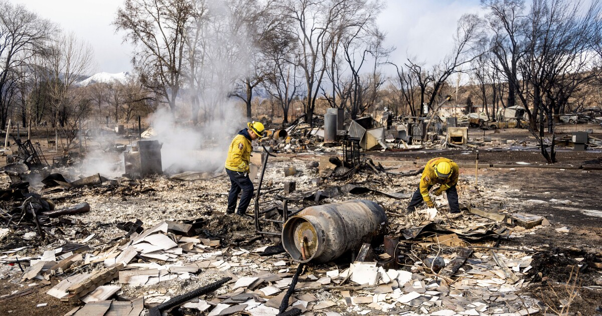 Deadly fire ravages Eastern Sierra town, then rains douse it, sheriff says