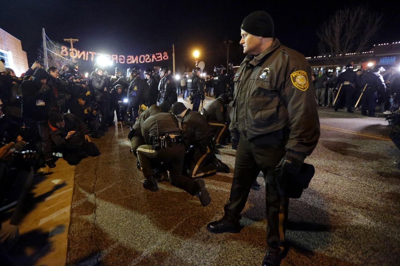 Police take people into custody in Ferguson, Mo., on Nov. 25.