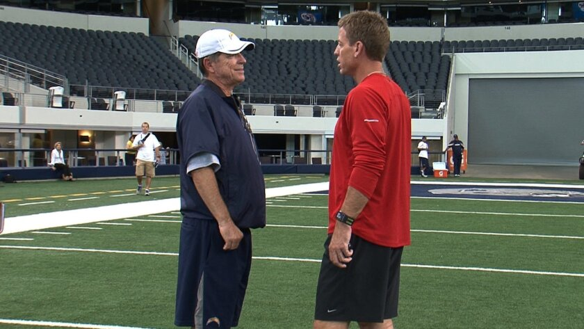 Troy Aikman talks to Norv Turner after practice at Cowboys Stadium.