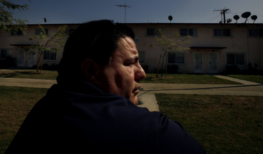 Hector Chacon, 44, visits the Boyle Heights housing project where he grew up. In politics, he and his family have prospered.