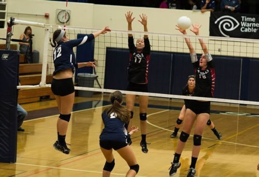 La Jolla High's Simone Stavros (17) and Madeleine Gates (18) defend against San Dieguito outside hitter Amanda Colla (12) in the Vikings' 3-1 loss in CIF Division 1 first round playoffs. La Jolla had no solution for Colla, who had 21 kills.