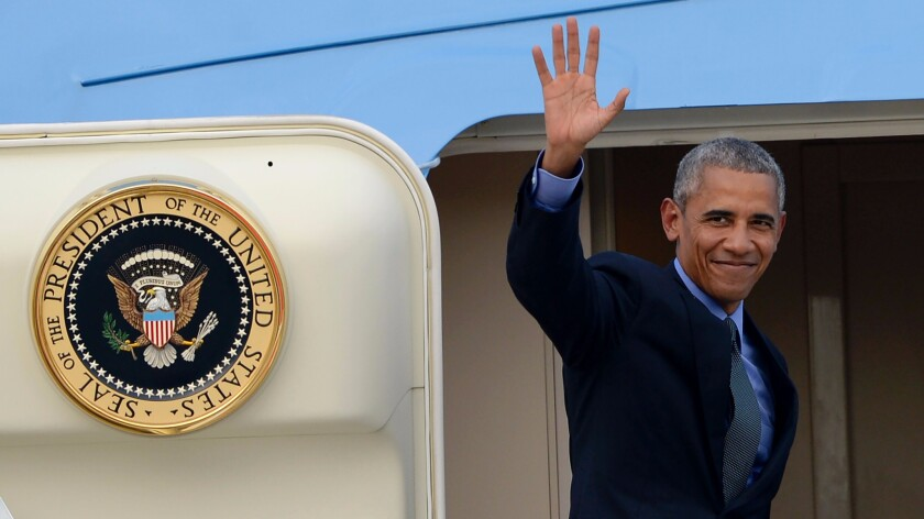 President Obama boards Air Force One in Vientiane, Laos, at the end of a trip to Asia for a pair of international summits.