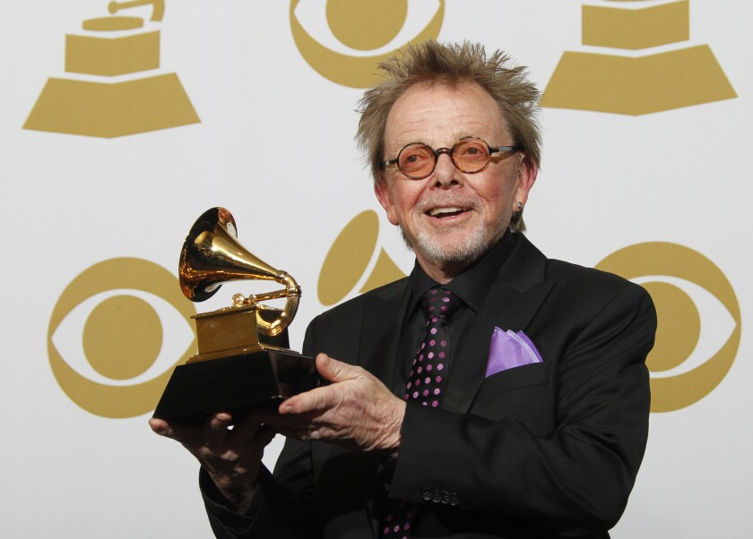 """Paul Williams, a collaborator on Daft Punk's album """"Random Access Memories,"""" shows off his Grammy for album of the year."""