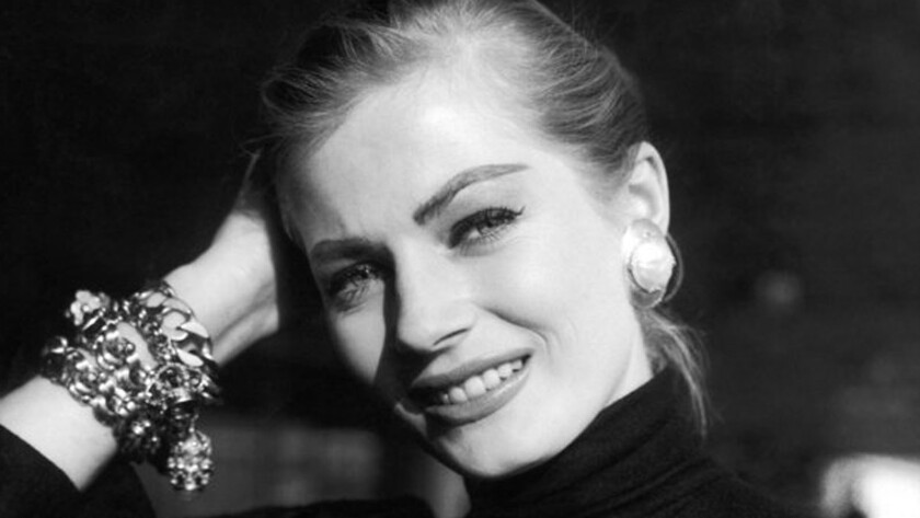 """Anita Ekberg poses for a photograph on her arrival at London airport from Stockholm in 1955 to take part in the film """"Zarak."""""""