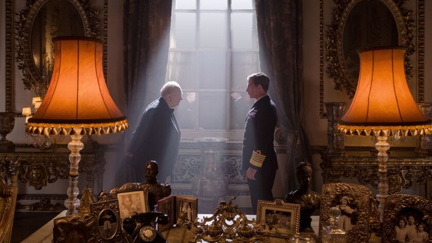 This image released by Focus Features shows Gary Oldman as Winston Churchill, left, and Ben Mendelso