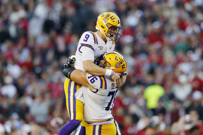 LSU quarterback Joe Burrow (9) celebrates after throwing a 13-yard touchdown pass during the second quarter against Alabama on Saturday. The Tigers won 46-41.