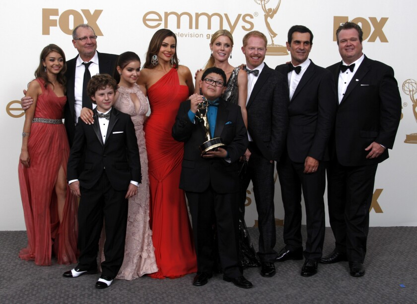 "The ""Modern Family"" cast hoists one of its earliest Emmys."