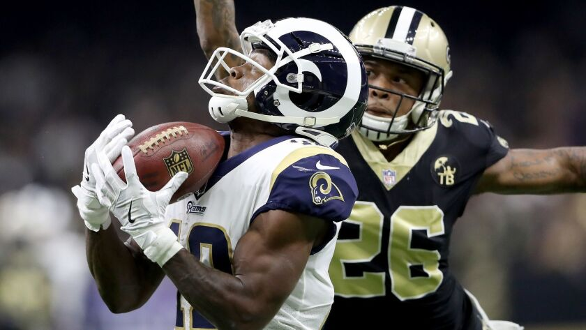 Rams wide receiver Brandin Cooks, left, hauls in a pass ahead of Saints cornerback P.J. Williams during the second quarter of Sunday's game.