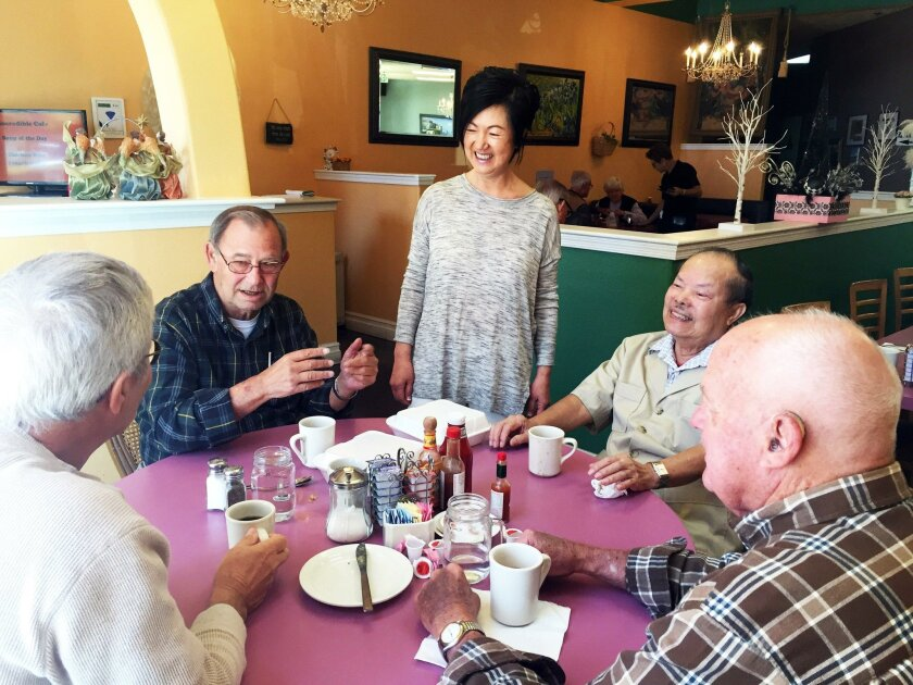 """Incredible Cafe owner Liz Song (center) jokes with four of her regulars who come every Tuesday morning for breakfast, from left, Nick Carovich, Bill Johnson, Kinh """"King"""" Nguyen and Bob Cowie, who all live on the same cul-de-sac."""