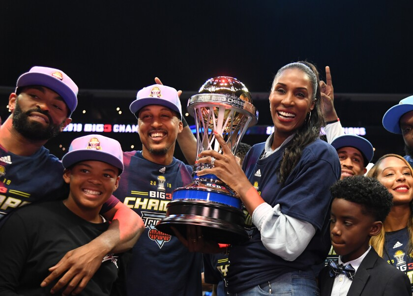Triplets head coach Lisa Leslie, Jamario Moon celebrate with the trophy after defeating the Killer 3s to win the BIG3 Championship at Staples Center on Sunday.