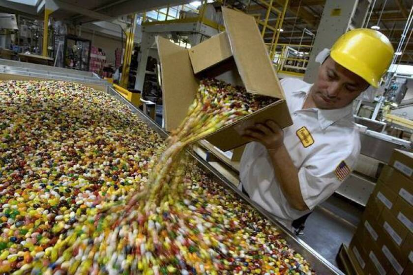 A Jelly Belly Candy Co. worker empties jelly beans into a bin